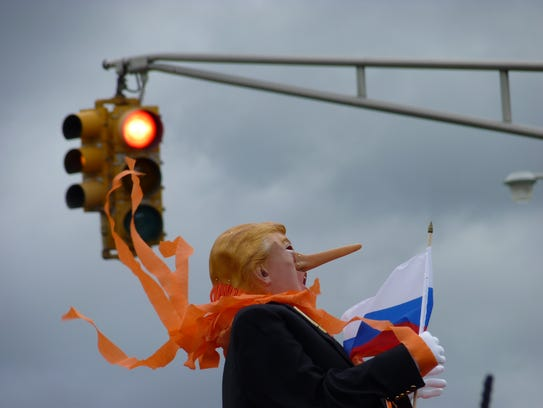 The ribbons around the Donald Trump effigy's neck blow