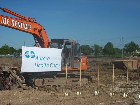 Aurora Health Care broke ground on a new Dewey Street