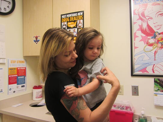 Bradi Bratz holds her daughter, London, after the two