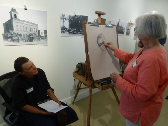 Judy King of Redding sketches a portrait Thursday of