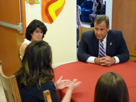 Gov. Chris Christie listens to a woman's story about