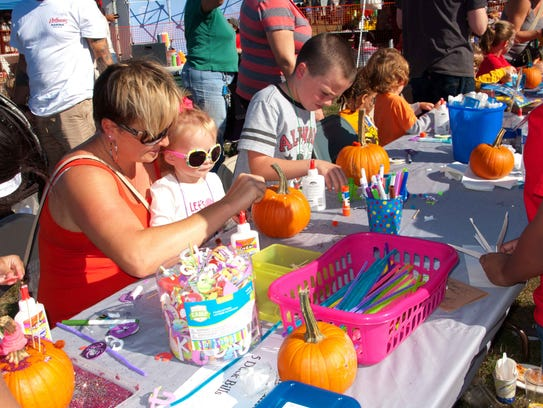 Families paint pumpkins at the annual Raritan River