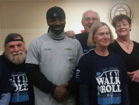 Forgotten Harvest Driver Khalid Peterson (second from