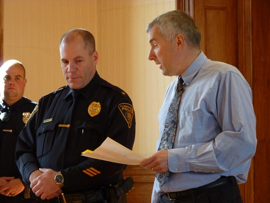 Councilman and Police Commissioner Marc Hain, right,