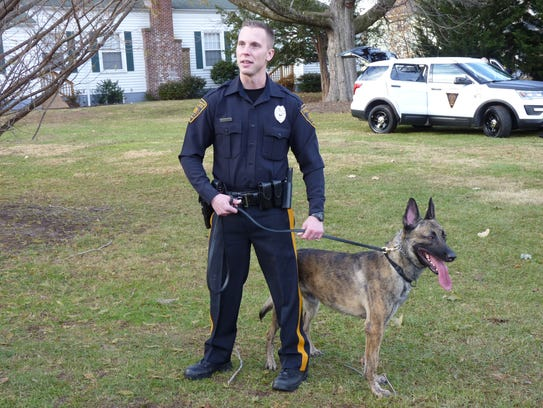 Patrolman Greg Zytko and his canine partner Jax.