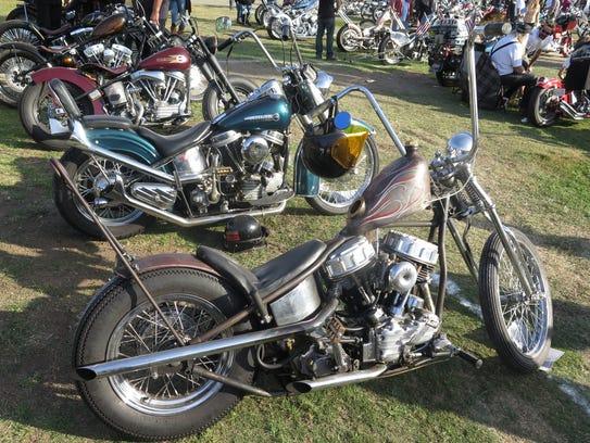 Custom, vintage Harley Davidson bikes are displayed
