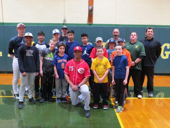 Former MLB player Milt Thompson(center) provides useful