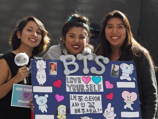Fans of BTS pose with handmade posters for their idols outside the American Music Awards in Los Angeles last month.