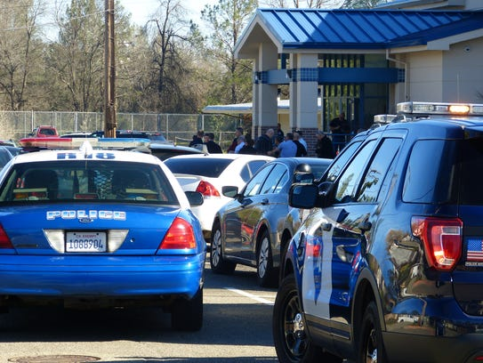 Law enforcement officers are shown on Feb. 7 investigating an officer-involved shooting near Buckeye School of the Arts in Redding.