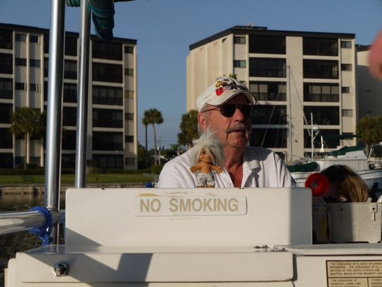 Capt. Bob Beckstrom sails with a troll doll as first