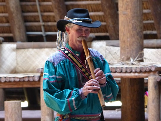 Robin Tillery playing flute at Mission San Luis.