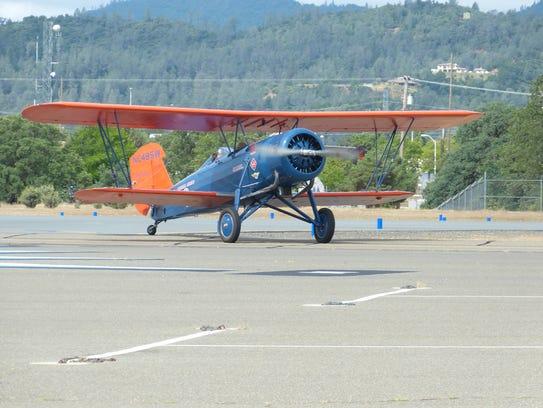 One of three Stearman Speedmail biplanes lands Wednesday