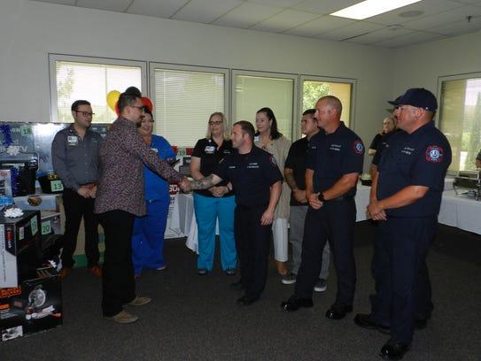 An award was presented to Andy Ruiz, Jesse Ramirez