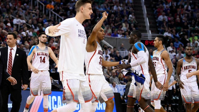 March 16, 2017; Salt Lake City, UT, USA; Arizona Wildcats forward Lauri Markkanen (10) and guard Allonzo Trier (35) react during a time out against the North Dakota Fighting Hawks in the first half in the first round of the NCAA tournament at Vivint Smart Home Arena.