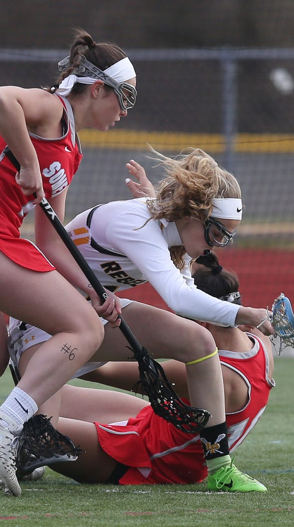 Girls lacrosse isn't totally without contact, as is