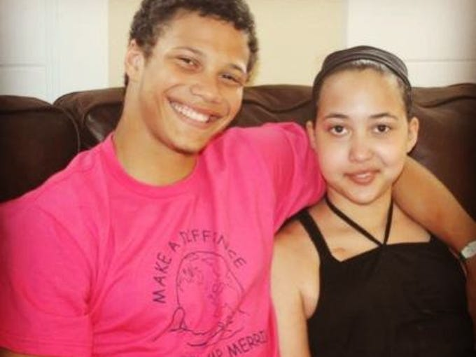 Benjamin Brown poses for a photo with his sister, Madison,