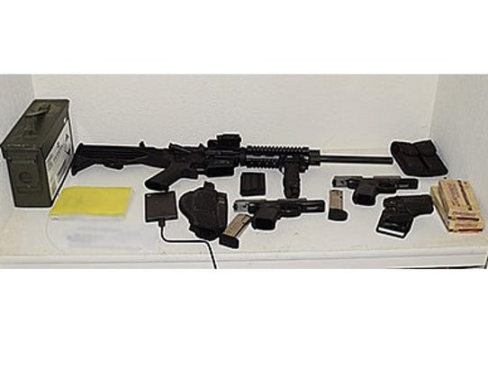 This loaded Ar-15 rifle and two loaded handguns were