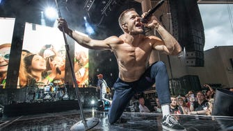 Imagine Dragons lead vocalist, Dan Reynolds, takes the stage during a  performance at Ruoff Home Mortgage Music Center in Noblesville Ind. on Friday, June 22, 2018.