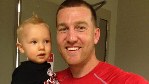 Reds infielder Todd Frazier poses with 1-year-old son