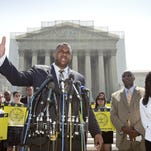 Ryan P. Haygood, director of the NAACP Legal Defense Fund, talks outside the Supreme Court in Washington on Tuesday, about the Shelby County v. Holder, a voting rights case in Alabama. Charles White, the national field director for the NAACP is second from right and Sherrilyn Ifill, president of the NAACP Legal Defense Fund is at right. AP Ryan P. Haygood, director of the NAACP Legal Defense Fund, talks outside the Supreme Court in Washington, Tuesday, June 25, 2013, about the Shelby County v. Holder, a voting rights case in Alabama. Charles White, the national field director for the NAACP is second from right and Sherrilyn Ifill, president of the NAACP Legal Defense Fund is at right. The Supreme Court says a key provision of the landmark Voting Rights Act cannot be enforced until Congress comes up with a new way of determining which states and localities require close federal monitoring of elections. (AP Photo/J. Scott Applewhite)