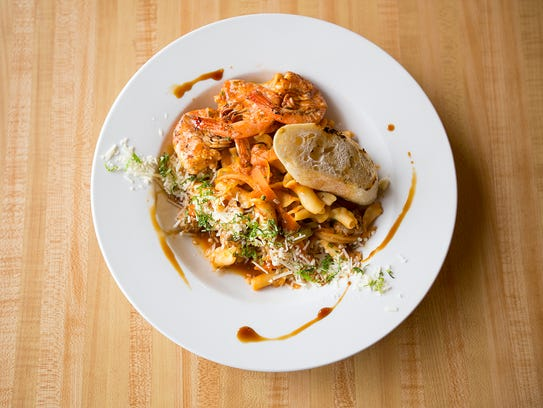 The sausage and shrimp bolognese served at the Iron