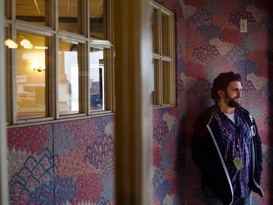 Program Coordinator Nick Hanges poses for a portrait
