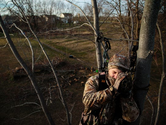 Jasen Hammer, 27 of Grimes, looks out over a field