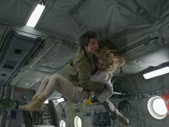 Tom Cruise and Annabelle Wallis see action in a scene from 'The Mummy.'