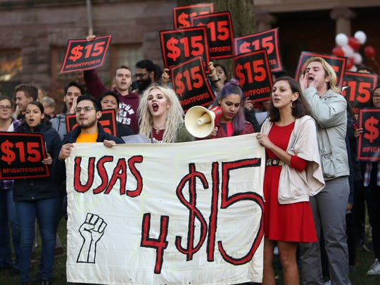 Students protest loudly, interrupting the speech by President Robert Barchi demanding $15 per hour during a ceremony celebrating Rutgers 250th anniversary at Old Queens. November 10, 2016, New Brunswick, NJ.