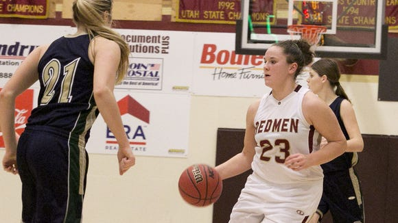 Cedar's Courtney Morley runs the break against Snow Canyon in a game from earlier this season.