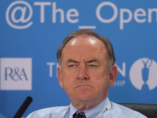 FILE - This is a Wednesday July 17, 2013 file photo of The Royal and Ancient Golf Club's Chief Executive Peter Dawson las he istens during a press conference ahead of the British Open Golf Championship at Muirfield, Scotland. Peter Dawson is to retire from his position as chief executive of Royal & Ancient after 16 years with the governing body in charge of the Rules of Golf and organizing the British Open. The R&A said Tuesday April 22, 2014  that Dawson will step down in September next year and will be also leaving his role as secretary of Royal and Ancient Golf Club, the 2,400-member club whose headquarters overlook the Old Course at St. Andrews.  (AP Photo/File)