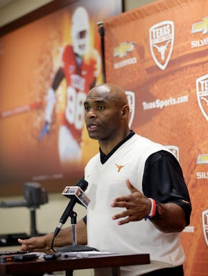 New Texas football coach Charlie Strong talks about his recruiting class during a news conference. Strong only had a month to scramble to keep the Longhorns recruiting class together.