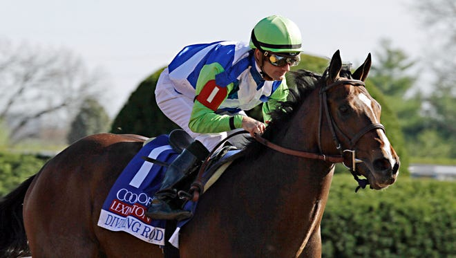 Jockey Julien Leparoux rides Divining Rod to a three-length victory in the Lexington Stakes horse race at Keeneland in Lexington, Ky., on Saturday.