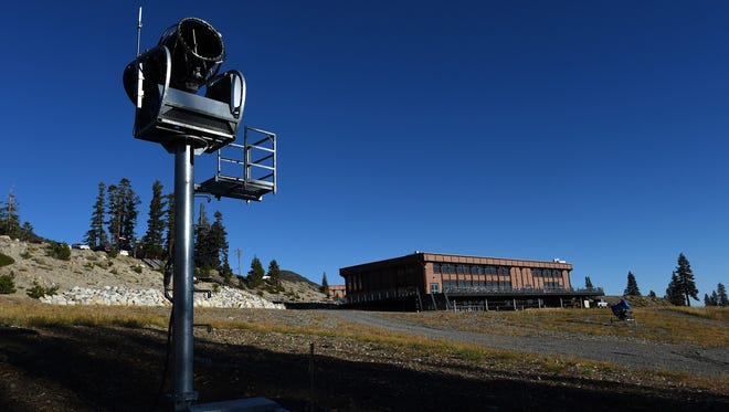 An automated snow making machine is seen at the base of the Mt. Rose Ski Area near Reno on Oct. 6, 2015.