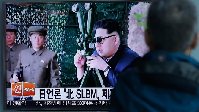 A South Korean man watches a TV news program showing an image published Sunday in North Korea's Rodong Sinmun newspaper of North Korean leader Kim Jong Un.