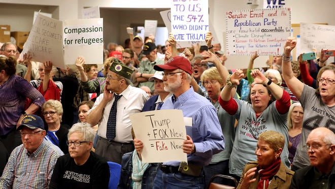 Hundreds of people, many of them protesters, packed the Maquoketa City Hall Council Chambers Tuesday, Feb. 21, 2017, for what was supposed to be a Veterans Roundtable Discussion with Iowa Senator Joni Ernst, in Maquoketa, Iowa. Most of the protesters centered around the Republican-led effort to repeal and replace the Affordable Care Act. Many of the veterans in attendance were annoyed with the protests. Republicans from Congress have encountered hostile crowds during public events across the country since efforts started to repeal the ACA. (Kevin E. Schmidt/Quad City Times via AP)