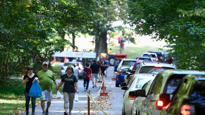 Shoppers wind through Henderson's Audubon State Park for the Lions Arts and Crafts Festival Saturday, October 7, 2017.