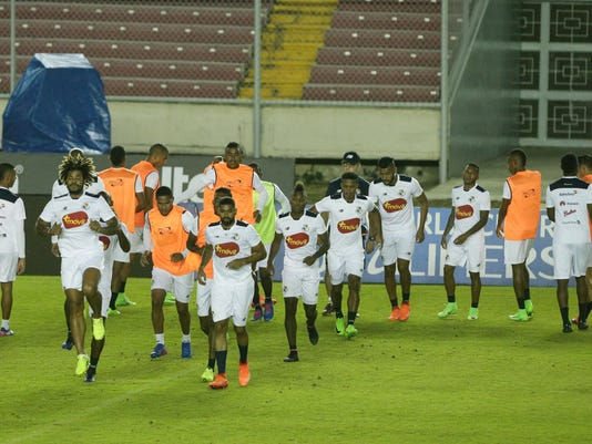 Panama's soccer players warm up during a training session in Panama City, Monday, March 27, 2017. Panama will face United States for 2018 World Cup qualifying soccer match on Tuesday. (AP Photo/Arnulfo Franco)