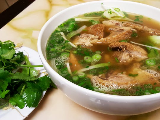 The Yellow Noodle with barbecue duck special ($10.99) has a chicken broth base with green onions, bok choy and white onion. The dish comes with bean sprouts, cilantro and a wedge of lime.
