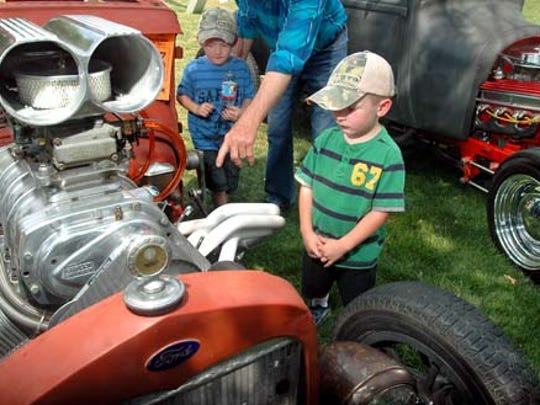 Tyler Kropf, right, and his brother Kelly of Las Cruces check out a 1930 Ford sedan during a recent Kiwanis Kars for Kids  car show at Young Park. The event also features a fishing clinic for kids and a pancake breakfast.