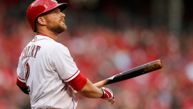 Cincinnati Reds shortstop Zack Cozart (2) watches foul ball fly in the top of the ninth inning of the MLB Opening Day game between the Cincinnati Reds and the Philadelphia Phillies at Great American Ball Park in downtown Cincinnati on Monday, April 3, 2017. The Reds lost the season-opening game to the Phillies, 4-3.