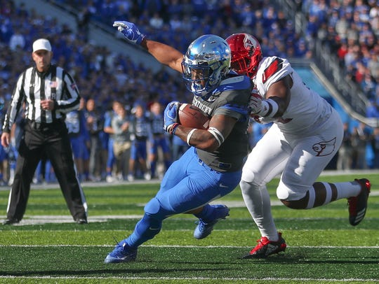 Kentucky's Benny Snell runs during UK's 2017 game against Louisville.