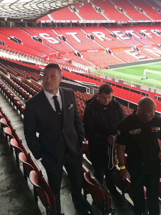 Boxer Joseph Parker, left, in the stands at Old Trafford soccer stadium in Manchester, England, Thursday Sept. 21, 2017, to meet with contender Hughie Fury ahead of their contest for the WBO heavyweight title.  Heavyweight champion Joseph Parker arrived in a tailored suit for a final media conference ahead of the second defense of his WBO belt against Highie Fury on upcoming Saturday. (Steve Douglas/AP Photo)
