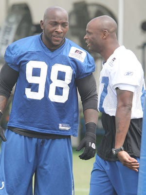 Robert Mathis and Reggie Wayne are seen during practice. The Colts held an afternoon practice Thursday August 4, 2011 at training camp in Anderson. Rob Goebel/The Star.