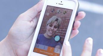 Alex Iarocci adjusts her Selfie with the SkinneePix app