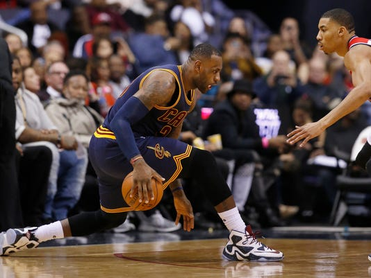 Cleveland Cavaliers forward LeBron James (23) works the ball as Washington Wizards forward Otto Porter Jr. defends duirng the second half of an NBA basketball game Wednesday, Jan. 6, 2016, in Washington. The Cavaliers won 121-115. (AP Photo/Alex Brandon)