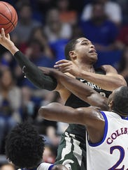 Kansas' Dwight Coleby defends Michigan State's Miles