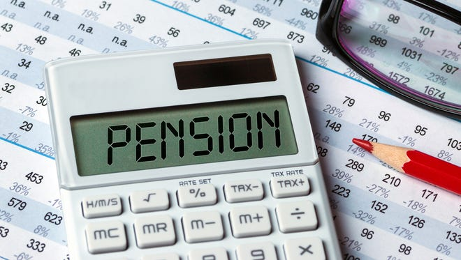 Pension concept shown on calculator.