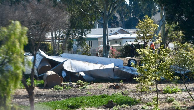 A semitrailer that overturned in Ventura Monday morning as it transitioned from northbound Highway 101 to the Santa Paula Freeway ended up on greenway next to highway. The incident caused significant backup in the area.