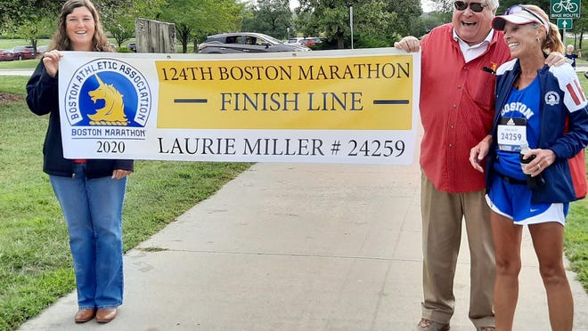 Laurie Miller completed the Boston Marathon virtually this year because the race was canceled. Miller ran 26.1 miles this past weekend in Lawrence in front of family and friends. [SUBMITTED PHOTO].